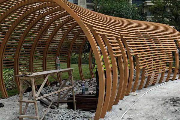 广州荔湾区鹤洞路广钢工人体育馆钢构廊架木纹